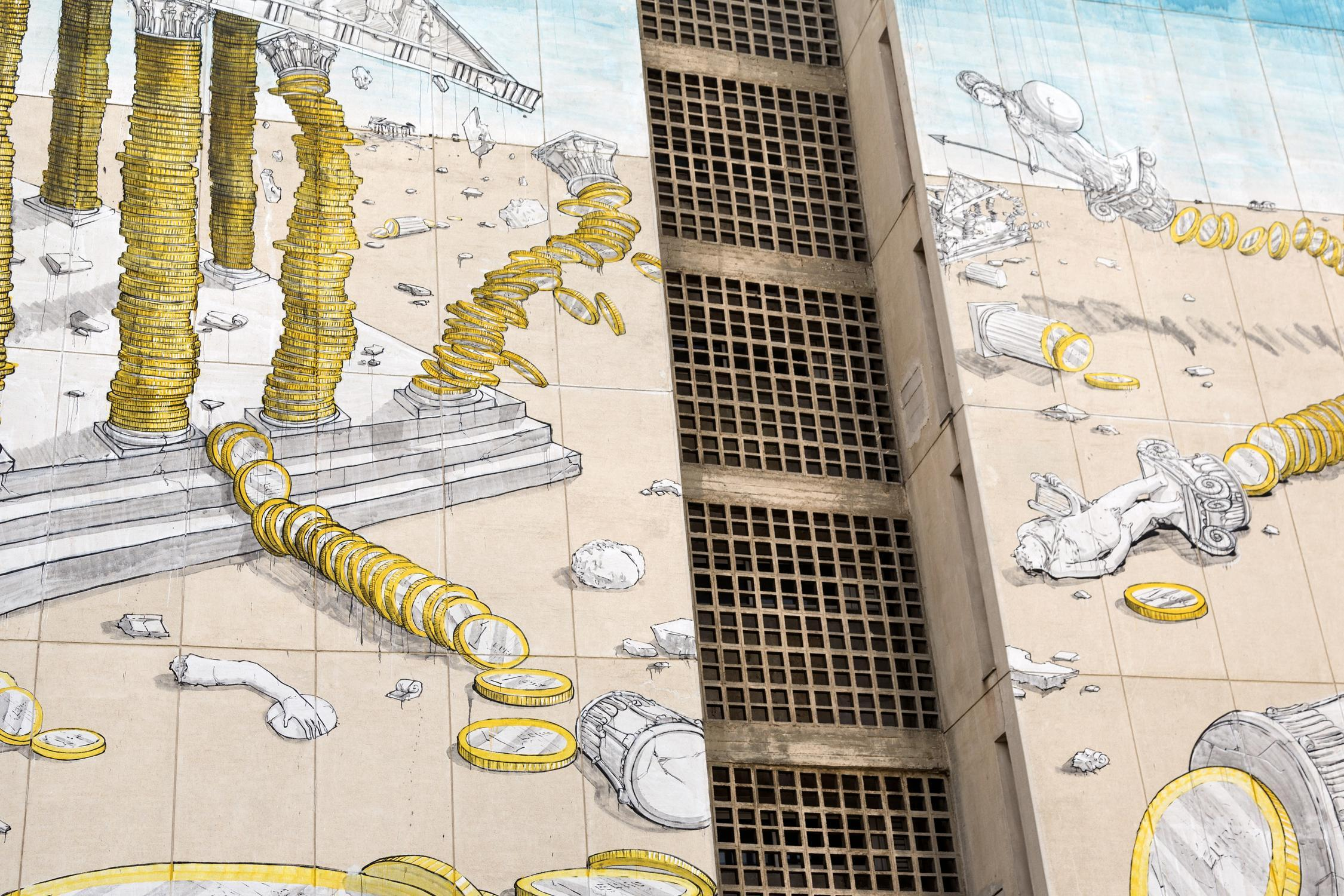 "A mural by graffiti artist ""Blu"" that depicts the Greek ailing economy on a wall in the northern Greek city of Thessaloniki. / Μια τοιχογραφία από τον καλλιτέχνη γκράφιτι ""Blu"" που απεικονίζει την προβληματική Ελληνική οικονομία σε έναν τοίχο στην Θεσσαλονίκη."
