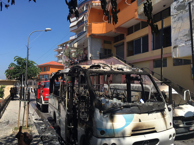 A burned bus is seen on the street in Kruja, 35 kilometers (22 miles) north of the capital, Tirana, Friday, May 27, 2016. Police say that one woman has died and 12 others were injured after a bus caught fire in northern Albania. The bus was taking 30 Christian Orthodox believers coming from the southwestern port city of Vlora to visit the castle of the Albanian national hero Skanderbeg, a 15th-century warrior. (AP Photo)