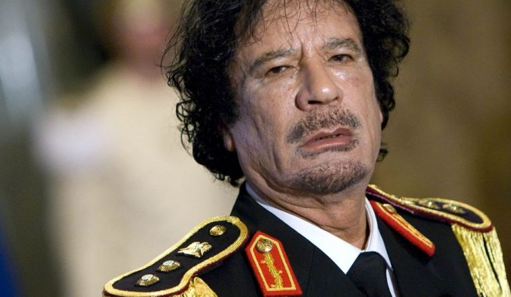 Libya's leader Muammar Gaddafi looks on during a news conference at the Quirinale palace in Rome June 10, 2009. REUTERS/Max Rossi (ITALY POLITICS HEADSHOT)