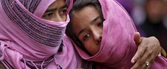 Kashmiri Muslim girls attend the funeral of Bilal Ahamd, a suspected militant, in Karimabad village in south Kashmir April 6, 2016. Ahmad was killed in a gunbattle with Indian security forces on Tuesday evening in south Kashmir, and one residential house was damaged, local media reported.  REUTERS/Danish Ismail