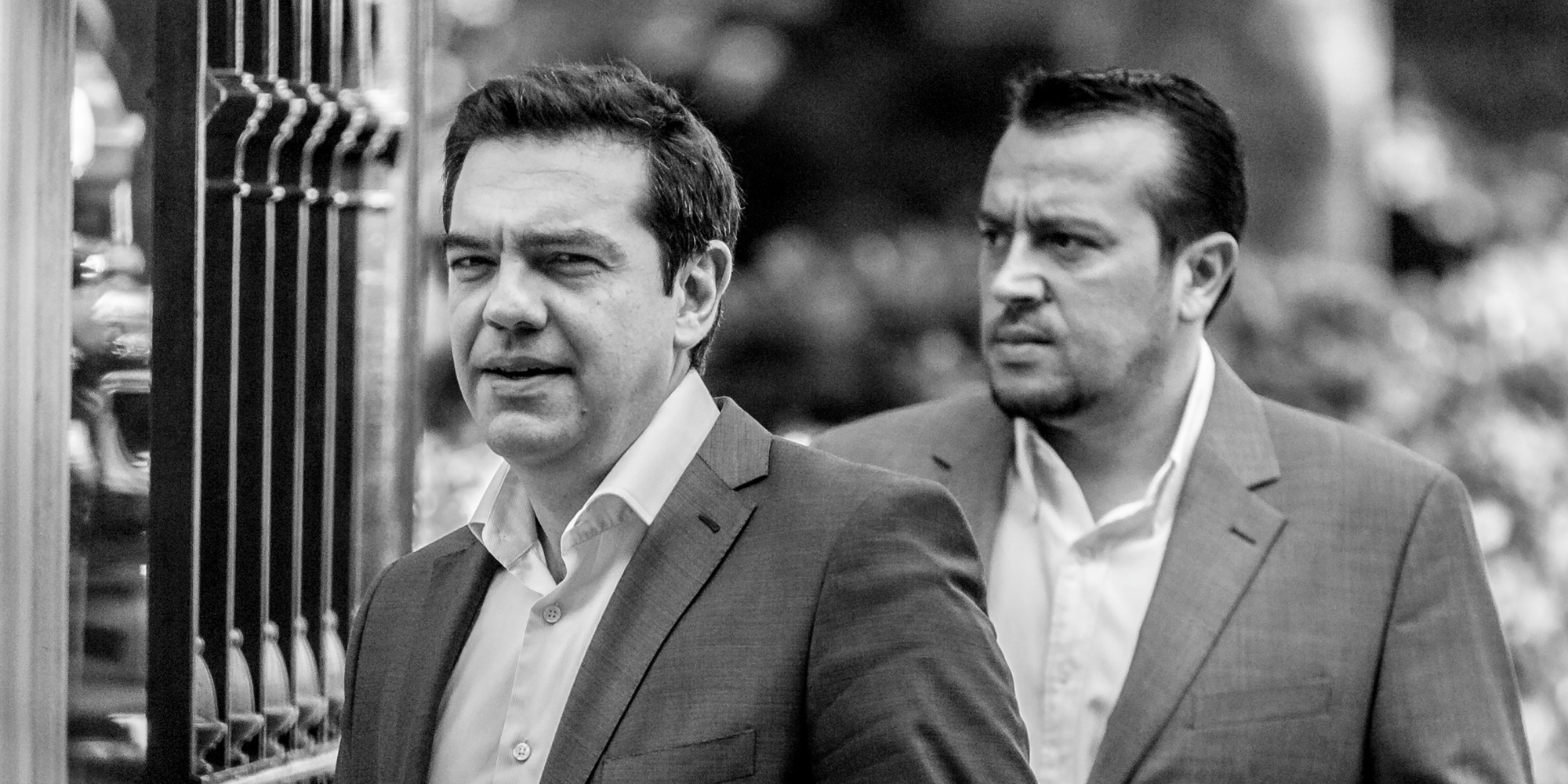 Alexis Tsipras, Greece's Prime Minister, left, and Nikos Pappas, Greece's Minister of State, right, outside the Greek Presidential Palace after meeting with party leaders in Athens, Greece, on July 6, 2015, before the critical EU Summit in Brussels.