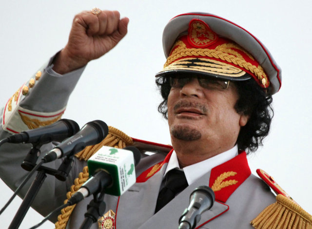 FILE - In this Saturday, June 12, 2010 file photo, Libyan leader Moammar Gadhafi talks during a ceremony to mark the 40th anniversary of the evacuation of the American military bases in the country, in Tripoli, Libya. The Associated Press is aware of reports that Moammar Gadhafi has been captured in Sirte. The chief spokesman for the revolutionary National Transitional Council Jalal el-Gallal and the council military spokesman Abdul-Rahman Busin told the AP that those reports are unconfirmed. (AP Photo/ Abdel Magid Al Fergany, File)