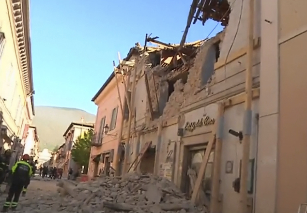 In this image made from video, firefighters stand in front of a damaged building in Norcia, Italy, Sunday, Oct. 30, 2016 after a powerful earthquake with a preliminary magnitude of 6.6 rocked central and southern Italy following a week of temblors left thousands homeless. (Sky Italia via AP)