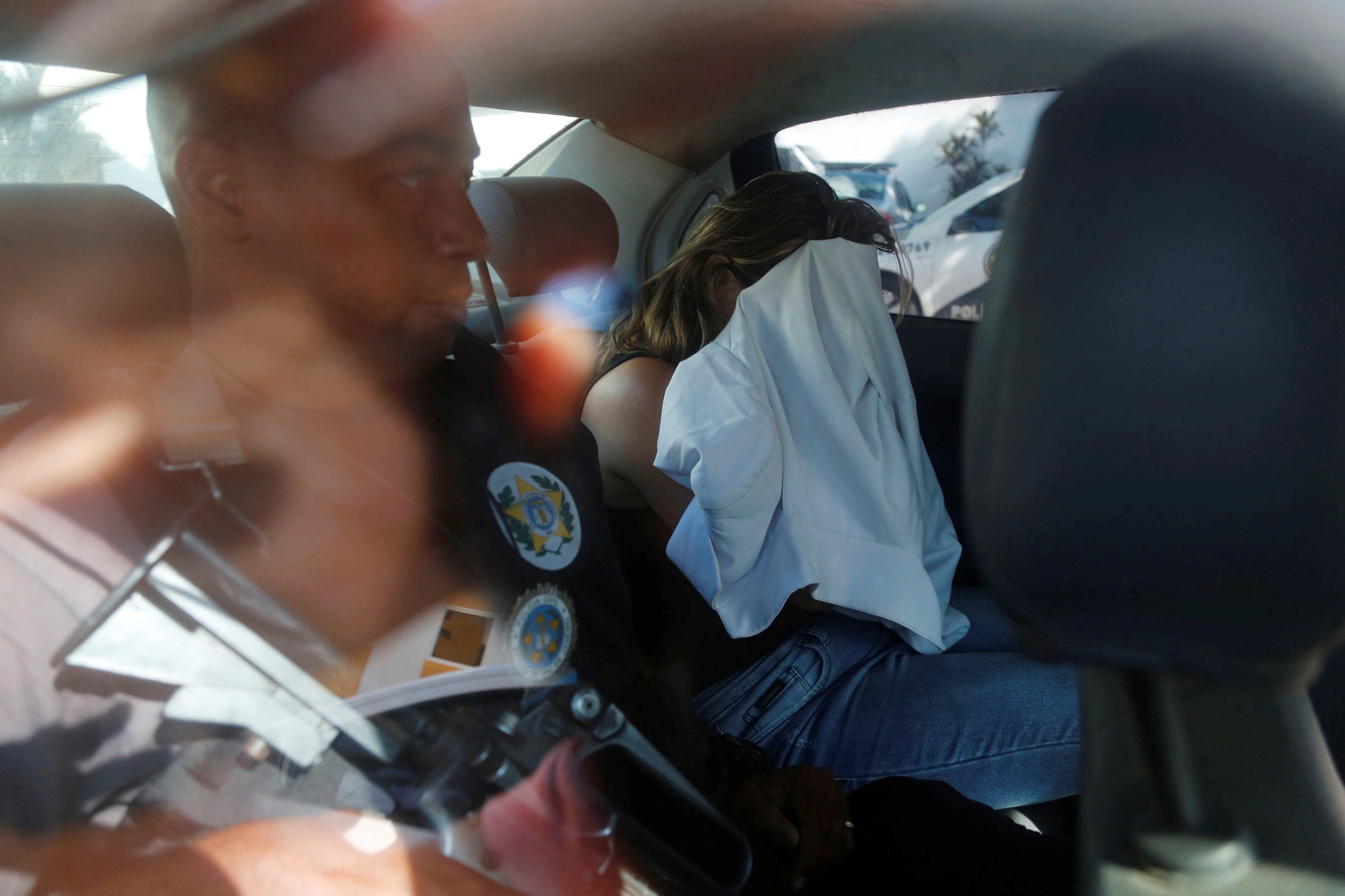Francoise Souza Oliveira, 40, wife of Greek Ambassador for Brazil Kyriakos Amiridis, is escorted by police officers as she is transferred from the police station to a jail in Belford Roxo, Brazil December 31, 2016. REUTERS/Marcos de Paula FOR EDITORIAL USE ONLY. NO RESALES. NO ARCHIVES