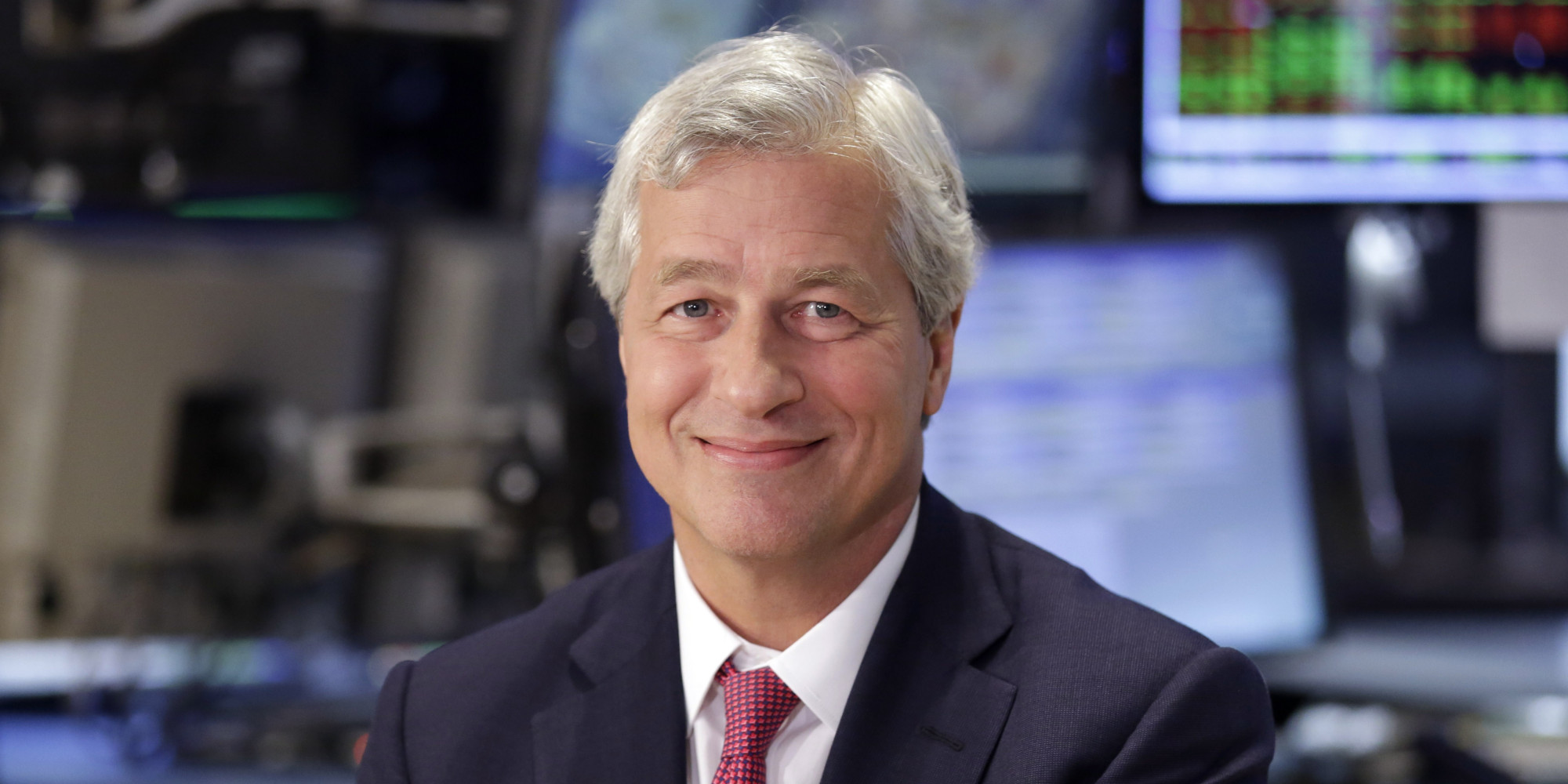 FILE - In this July 12, 2013 file photo, JP Morgan Chase Chairman and CEO Jamie Dimon is interviewed on the floor of the New York Stock Exchange. JPMorgan said Friday, Oct. 25, 2013, that it has agreed to pay $5.1 billion to resolve claims that it misled Fannie Mae and Freddie Mac about risky mortgage securities it sold them before the housing market collapsed. (AP Photo/Richard Drew, File)