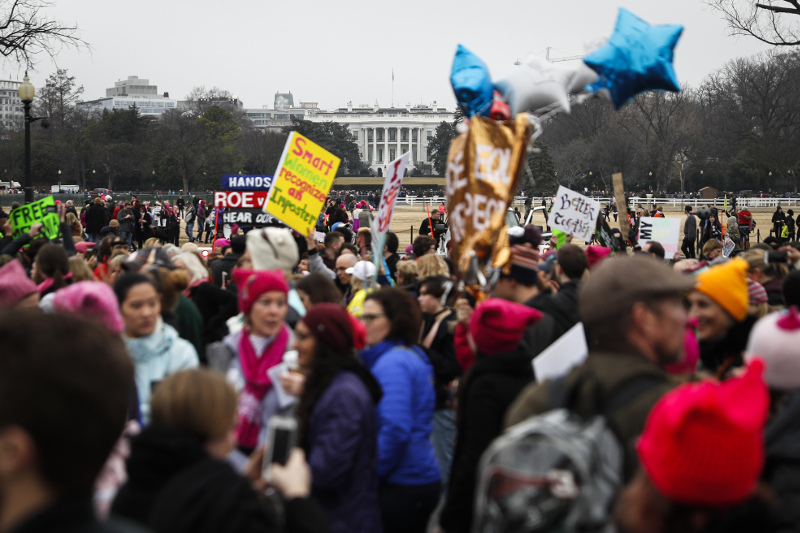 Protesters walk across Constitution Avenue near the White House for the Women's March on Washington during the first full day of Donald Trump's presidency, Saturday, Jan. 21, 2017 in Washington. Organizers of the Women's March on Washington expect more than 200,000 people to attend the gathering. Other protests are expected in other U.S. cities. (AP Photo/John Minchillo)