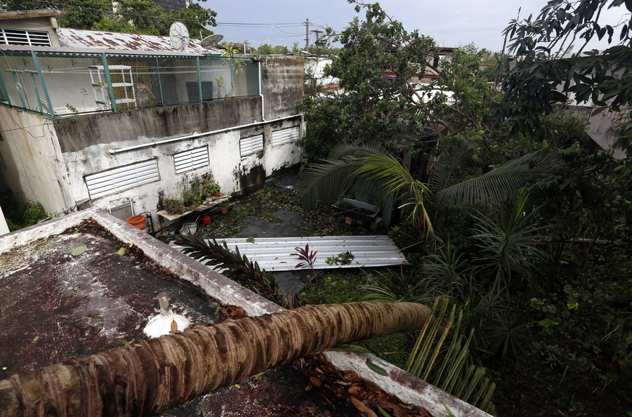 epa06190443 View of wreckage in the vicinity of the Santurce neighborhood in the aftermath of the hurricane Irma, in San Juan, Puerto Rico, 7 September 2017. Puerto Rico's Governor Ricardo Rossello, reported that three people have died in events related to the passage of Hurricane Irma, while the biggest incidents that have been recorded are fallen trees and electric poles. EPA/Thais Llorca
