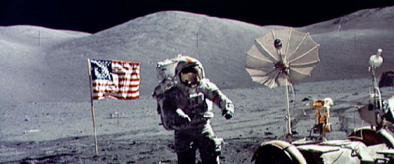 - FILE PHOTO DECEMBER 1972 - Twenty-five years ago tomorrow, on December 19, 1972, humans returned from another celestial body for the last time following the last Apollo mission. In this file photo, astronaut Eugene Cernan walks toward the Lunar Roving Vehicle (LRV) near the U.S. flag at the Taurus-Littrow landing site of Apollo 17. The photograph was taken by astronaut Harrison H. Schmitt, lunar module pilot. Cernan was the last human being to step on the moon as he was entered the Lunar Module after Schmitt for the return flight to earth.   ? QUALITY DOCUMENT