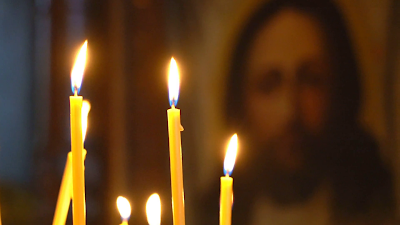 view-at-the-church-from-burning-candles-face-of-christ-in-the-icon-lick-holy-flame-lit-candles_hmkpgszle_thumbnail-full01