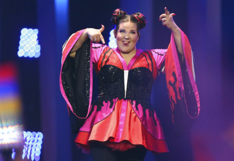 Netta from Israel gestures as she arrives on stage in Lisbon, Portugal, Saturday, May 12, 2018 before the Eurovision Song Contest grand final. (AP Photo/Armando Franca)