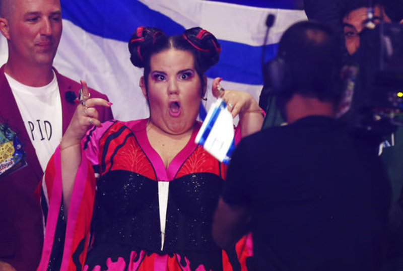 Netta from Israel poses for a camera man in Lisbon, Portugal, Saturday, May 12, 2018 during the Eurovision Song Contest grand final. (AP Photo/Armando Franca)