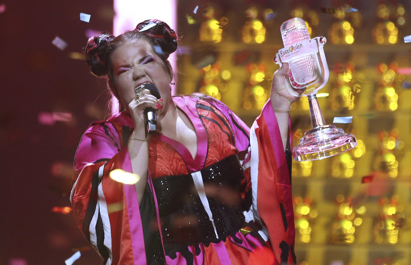 Netta from Israel celebrates after winning the Eurovision song contest in Lisbon, Portugal, Saturday, May 12, 2018 during the Eurovision Song Contest grand final. (AP Photo/Armando Franca)