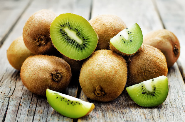 kiwi on white wood background. tinting. selective focus