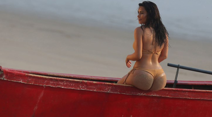 EXCLUSIVE: **PREMIUM EXCLUSIVE**Kim Kardashian shows off her famous booty in a nude-coloured bikini on a photo shoot in Thailand