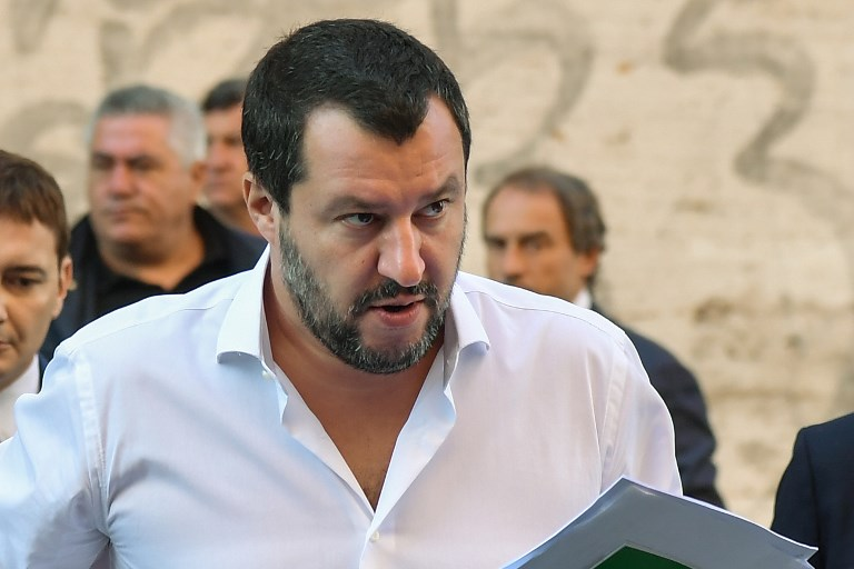"""Italy's Interior Minister, Matteo Salvini arrives on October 8, 2018 to the headquarters of the Unione Generale del Lavoro (UGL, General Union of Labor) trade union in Rome, to attend a debate on the theme """"Economic growth and social prospects in a Europe of Nations"""" with the leader of France's far-right National Rally (RN) party. (Photo by Tiziana FABI / AFP) / ALTERNATIVE CROP"""
