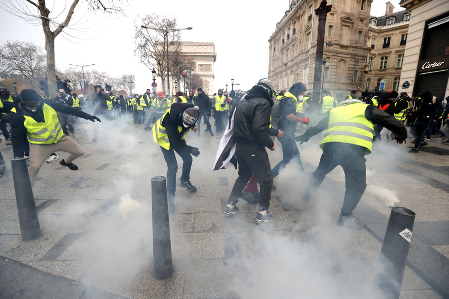 epa07216304 Some Yellow Vests (Gilets jaunes) protesters clash with police forces during a demonstration near the Champs Elysees in Paris, France, 08 December 2018. Police in Paris is preparing for another weekend of protests of the so-called 'gilets jaunes' (yellow vests) protest movement. Recent demonstrations of the movement, which reportedly has no political affiliation, had turned violent and caused authorities to close some landmark sites in Paris this weekend. EPA/IAN LANGSDON