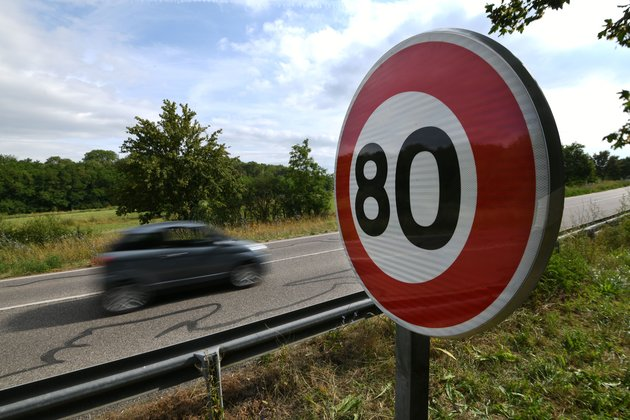 A car drives past a newly installed 80 KMPH speed limit sign sign on a road on June 29, 2018 in Wittenheim eastern France. - As of July 1, 2018 the speed limit on two lane roads from 90 KMPH to 80 KMPH, in the hope of addressing an alarming rise in the number of road deaths. (Photo by SEBASTIEN BOZON / AFP)        (Photo credit should read SEBASTIEN BOZON/AFP/Getty Images)