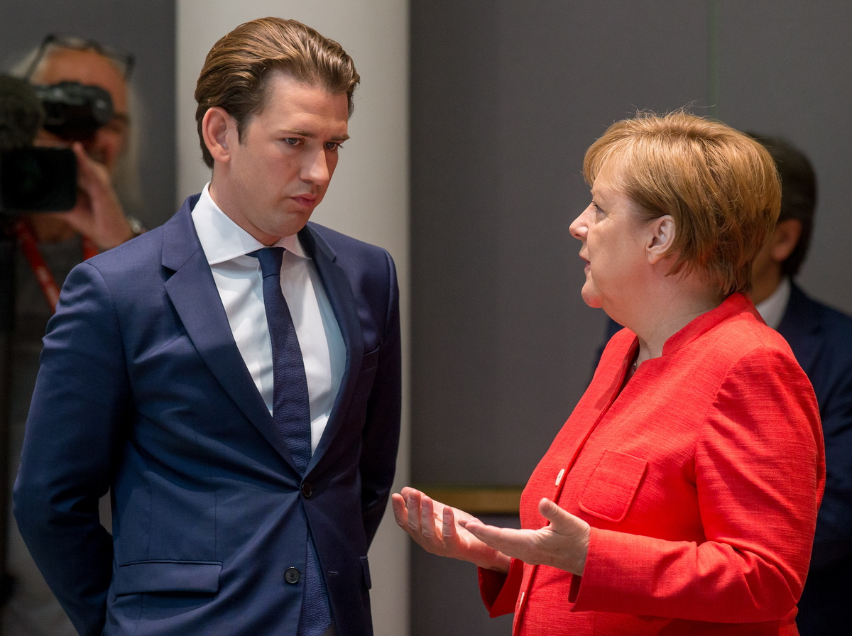 epa06849403 Austrian Chancellor Sebastian Kurz (L) and German Chancellor Angela Merkel  at the start of the second day of an European Council summit in Brussels, Belgium, 29 June 2018. EU countries' leaders meet on 28 and 29 June for a summit to discuss migration in general, the installation of asylum-seeker processing centers in northern Africa, and other security- and economy-related topics including Brexit.  EPA/STEPHANIE LECOCQ