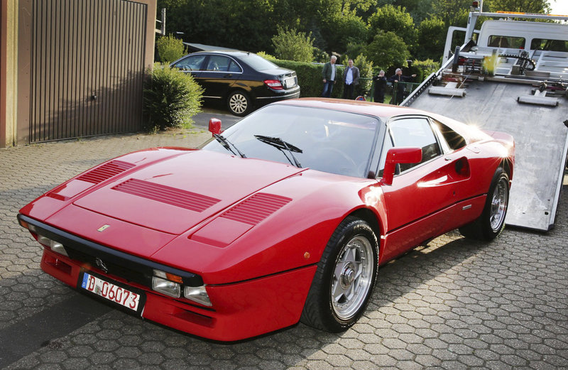 A Ferrari 288 GTO is pictured in Grevenbroich, Germany, May 15, 2019. German police have recovered a valuable 1980s Ferrari stolen during a test drive and are now searching for the man who is believed to have sped off with the car while posing as a would-be buyer. The red Ferrari 288 GTO, first registered in 1985, is believed to be worth more than 2 million euros ($2.2 million). (Dieter Staniek/dpa via AP)