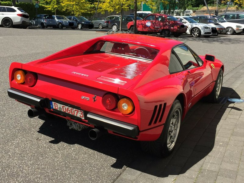 The Monday, May 13, 2019 photo provided by the police in Duesseldorf shows the Ferrari 288 GTO. German police have recovered a valuable 1980s Ferrari stolen during a test drive and are now searching for the man who is believed to have sped off with the car while posing as a would-be buyer. The red Ferrari 288 GTO, first registered in 1985, is believed to be worth more than 2 million euros ($2.2 million). (Police Duesseldorf via AP)