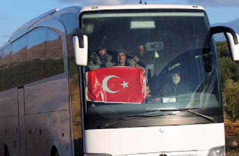 Fighters coming from Syria are pictured on a bus near the border city of Kilis, Turkey January 19, 2018. Baris Kadirhan/Depo Photos via REUTERS ATTENTION EDITORS - THIS PICTURE WAS PROVIDED BY A THIRD PARTY. NO RESALES. NO ARCHIVE. TURKEY OUT. NO COMMERCIAL OR EDITORIAL SALES IN TURKEY.