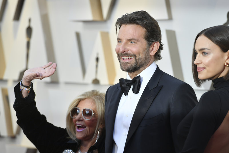 Gloria Campano, from left, Bradley Cooper, and Irina Shayk arrive at the Oscars on Sunday, Feb. 24, 2019, at the Dolby Theatre in Los Angeles. (Photo by Jordan Strauss/Invision/AP)