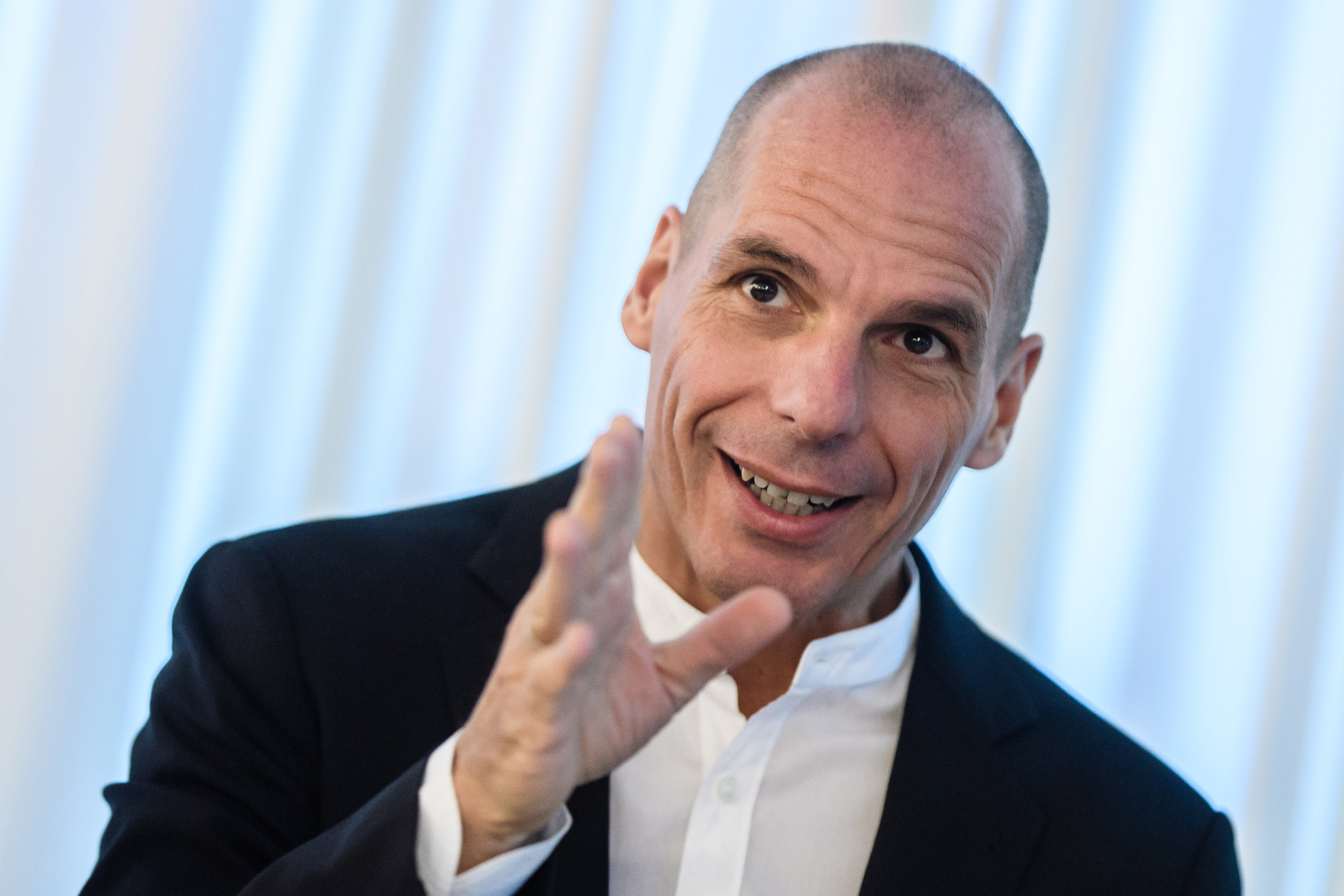 epa07189345 Former Greek finance minister Yanis Varoufakis gestures while speaking during a press conference on his election as top candidate of the movement 'Democracy in Europe Movement 2025' (DiEM25 ) in Berlin, Germany, 25 November 2018. Varoufakis was elected as their top candidate for the upcoming elections for the European Parliament which are due to take place from 23 to 26 May 2018.  EPA/CLEMENS BILAN