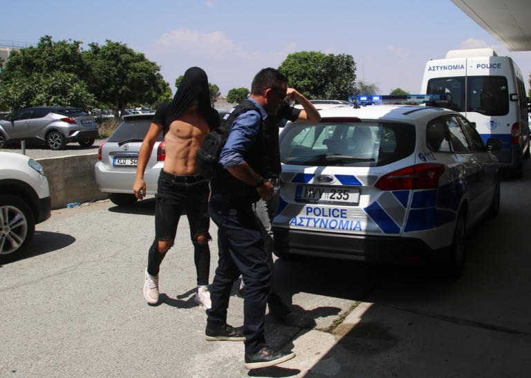 Israeli tourists, arrested over the alleged rape of a British tourist in the resort town of Ayia Napa, arrive to appear before a magistrate for a remand hearing in the Famagusta courthouse in Paralimni, Cyprus July 18, 2019. REUTERS/Yiannis Kourtoglou
