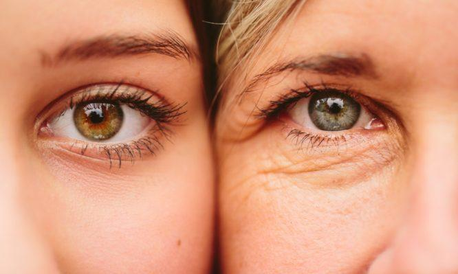 close-up-of-mother-and-daughter-faces-together-picture-id526427753-666x399