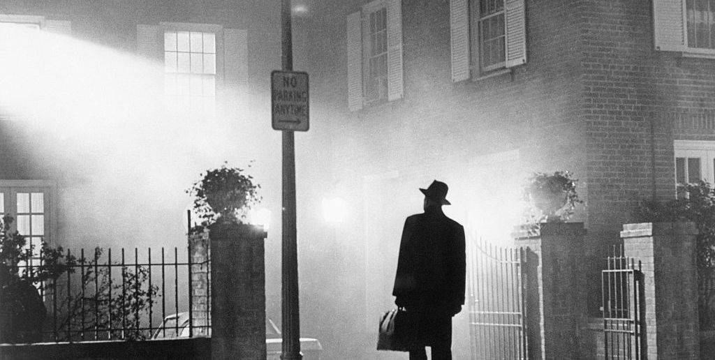 """(Original Caption) 1973- Movie still from """"The Exorcist"""" showing Max Von Sydow standing outside the McNeil home. This photograph was the one used in the advertising campaign for the film."""