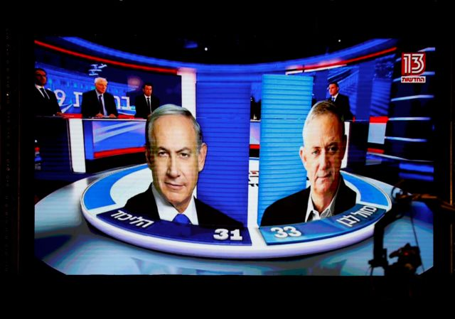 The results of the exit polls are shown on a screen at Benny Gantz's Blue and White party headquarters, following Israel's parliamentary election, in Tel Aviv, Israel, September 17, 2019. REUTERS/Amir Cohen