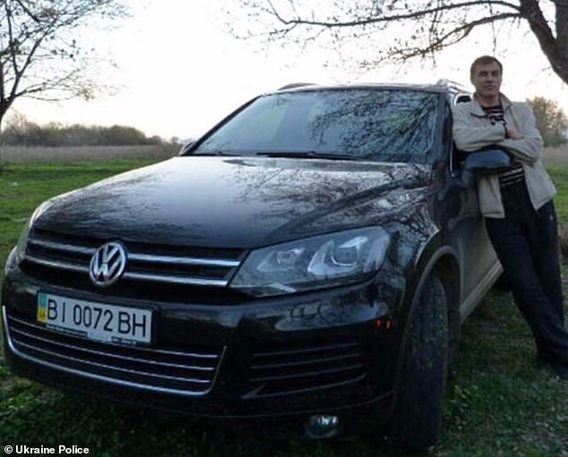 22010148-7772493-Yury_Beznischenko_pictured_with_his_Volkswagen_Touareg_was_ambus-a-50_1575902420721