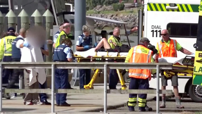 A person injured by the White Island volcano eruption is wheeled into a waiting ambulance on a stretcher in Whakatane, New Zealand, December 9, 2019, in this still image taken from video.  TVNZ via REUTERS TV   ATTENTION EDITORS - THIS IMAGE HAS BEEN SUPPLIED BY A THIRD PARTY. NO RESALES. NO ARCHIVES. NEW ZEALAND OUT. NO USE NEW ZEALAND INTERNET SITES / ANY INTERNET SITE OF ANY NEW ZEALAND OR AUSTRALIA BASED MEDIA ORGANISATIONS OR MOBILE PLATFORMS. IMAGE MASKED AT SOURCE.