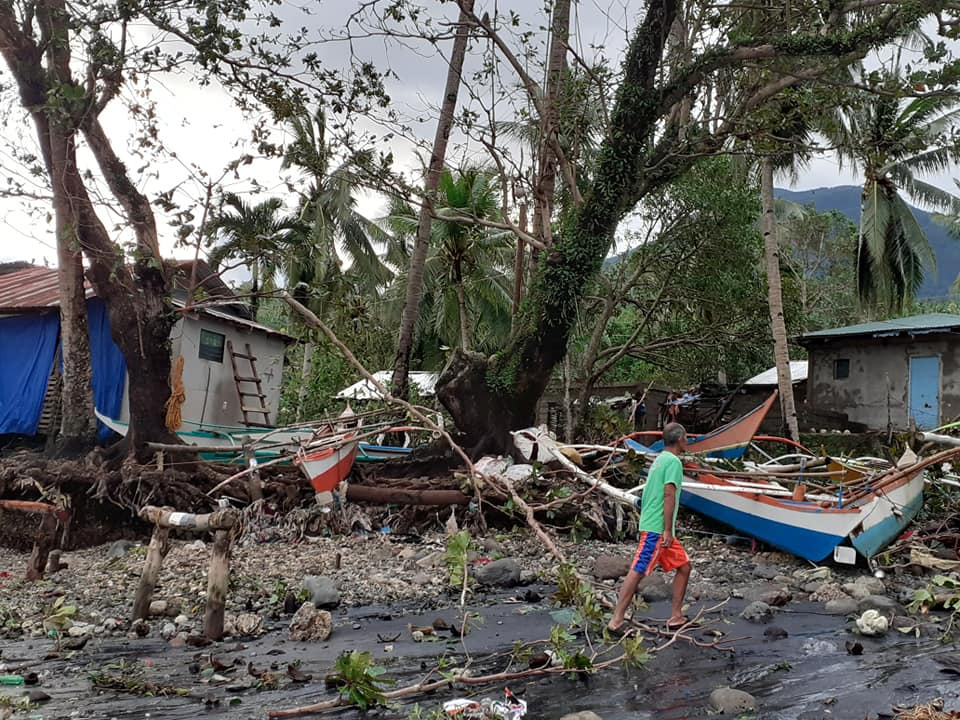 A man walks past storm debris in Biliran, Philippines December 26, 2019. in this picture obtained from social media. VERMALYN MALOLOY-ON NAVARRETE via REUTERS THIS IMAGE HAS BEEN SUPPLIED BY A THIRD PARTY. MANDATORY CREDIT. NO RESALES. NO ARCHIVES.