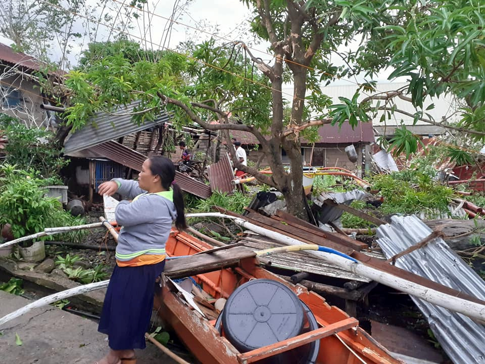 A woman is seen near storm debris in Biliran, Philippines December 26, 2019. in this picture obtained from social media. VERMALYN MALOLOY-ON NAVARRETE via REUTERS THIS IMAGE HAS BEEN SUPPLIED BY A THIRD PARTY. MANDATORY CREDIT. NO RESALES. NO ARCHIVES.