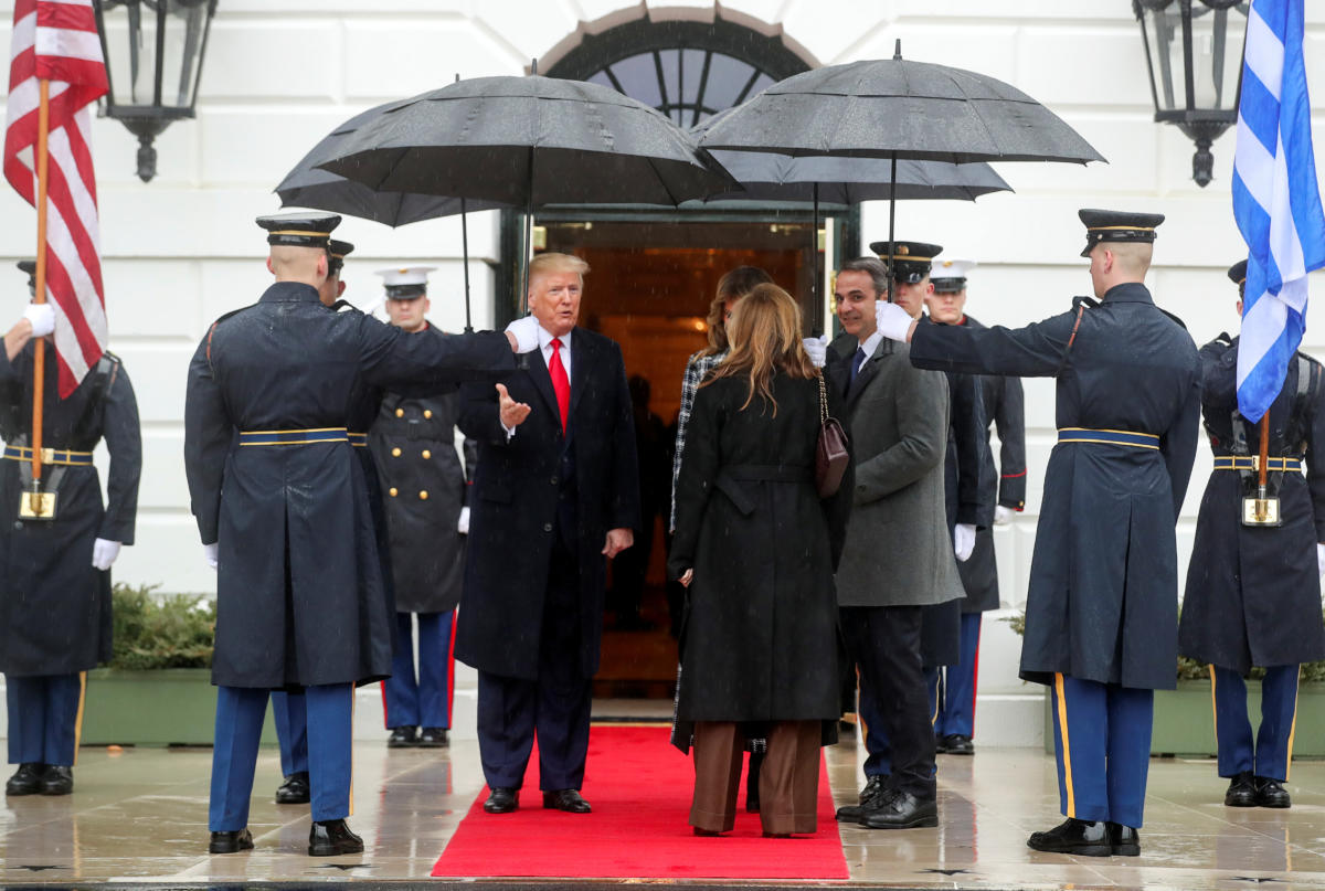 U.S. President Donald Trump and first lady Melania Trump welcome Greek Prime Minister Kyriakos Mitsotakis and Mareva Grabowski-Mitsotakis as they arrive at the White House in Washington, U.S., January 7, 2020. REUTERS/Jonathan Ernst