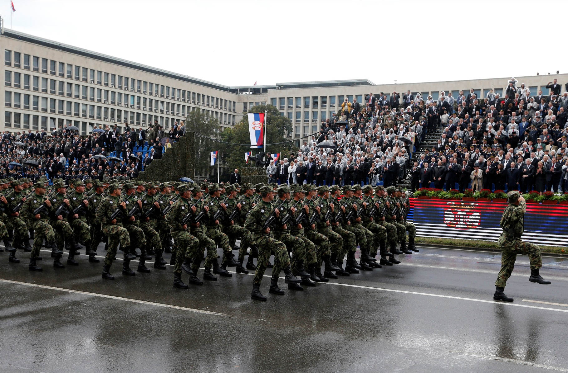Serbian troops march during a military parade to mark 70 years since the city's liberation by the Red Army in Belgrade October 16, 2014. Serbia feted Russia's Vladimir Putin with troops, tanks and fighter-jets on Thursday to mark seven decades since the Red Army liberated Belgrade, balancing its ambitions of European integration with enduring reverence for a big-power ally deeply at odds with the West. REUTERS/Marko Djurica (SERBIA  - Tags: POLITICS MILITARY ANNIVERSARY) - RTR4AGRC