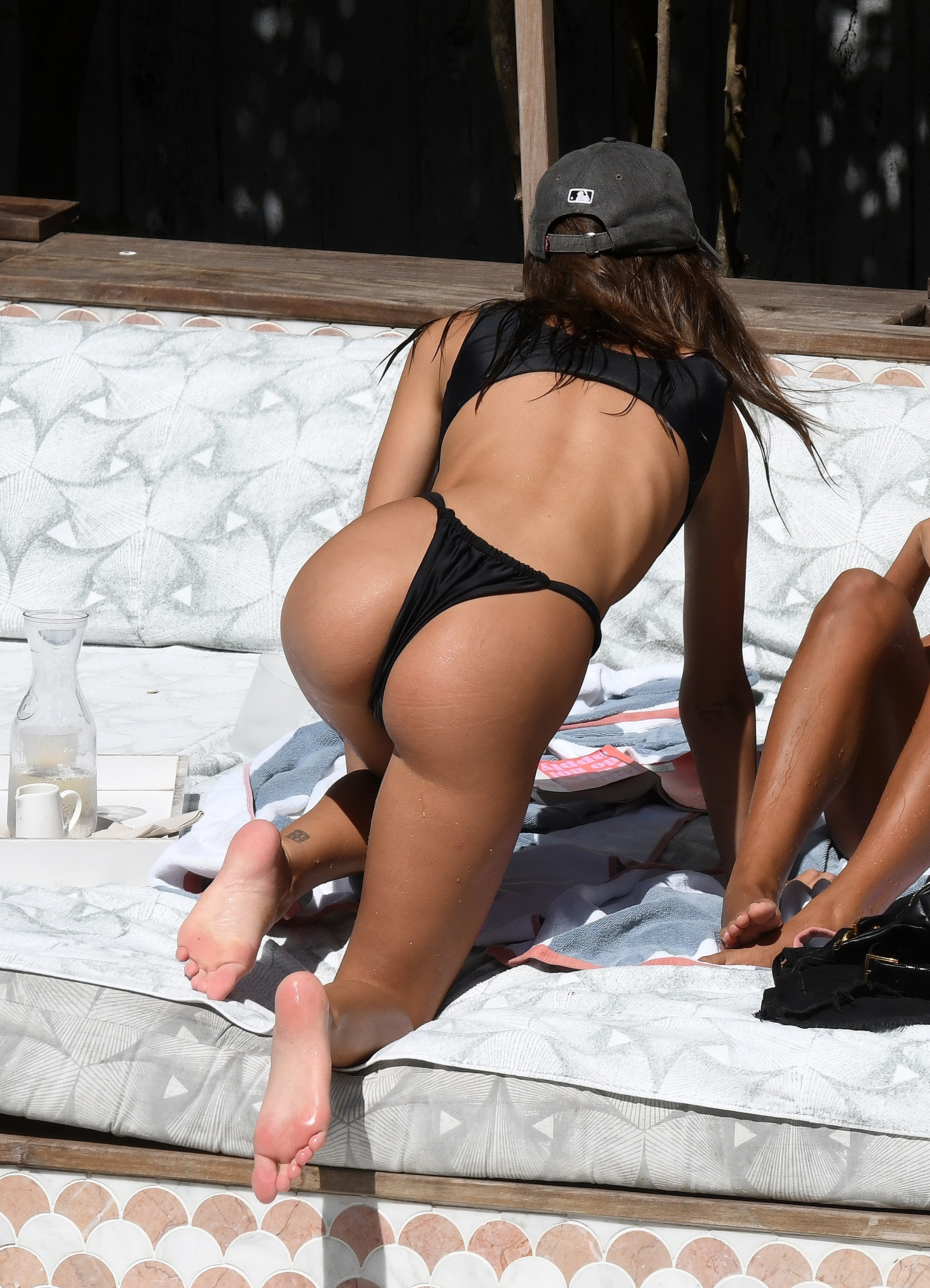Actress and model Emily Ratajkowski wears black bikini as she tops up her tan by the pool in Miami. 16 Oct 2019 Pictured: Emily Ratajkowski. Photo credit: MEGA TheMegaAgency.com +1 888 505 6342