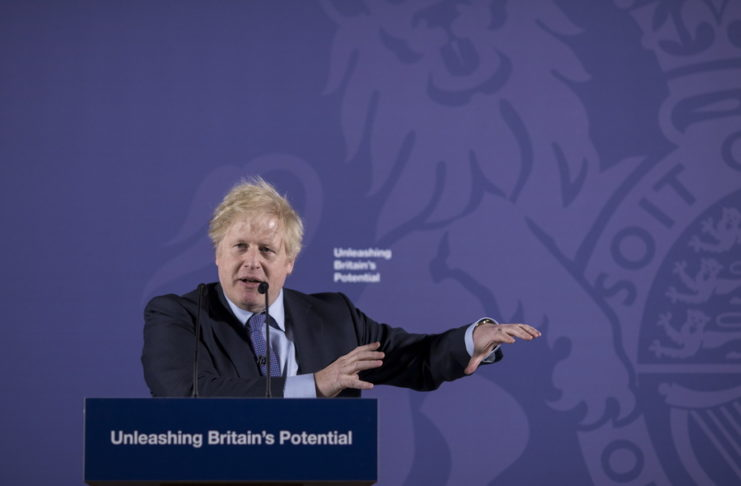 epa08190338 British Prime Minister Boris Johnson gestures as he delivers a speech on 'Unleashing Britain's Potential' at the Old Royal Naval College in London, Britain, 03 February 2020.  The United Kingdom officially left the EU on 31 January 2020, beginning an eleven month transition period with negotiations over a future trade deal.  EPA/Jason Alden / POOL