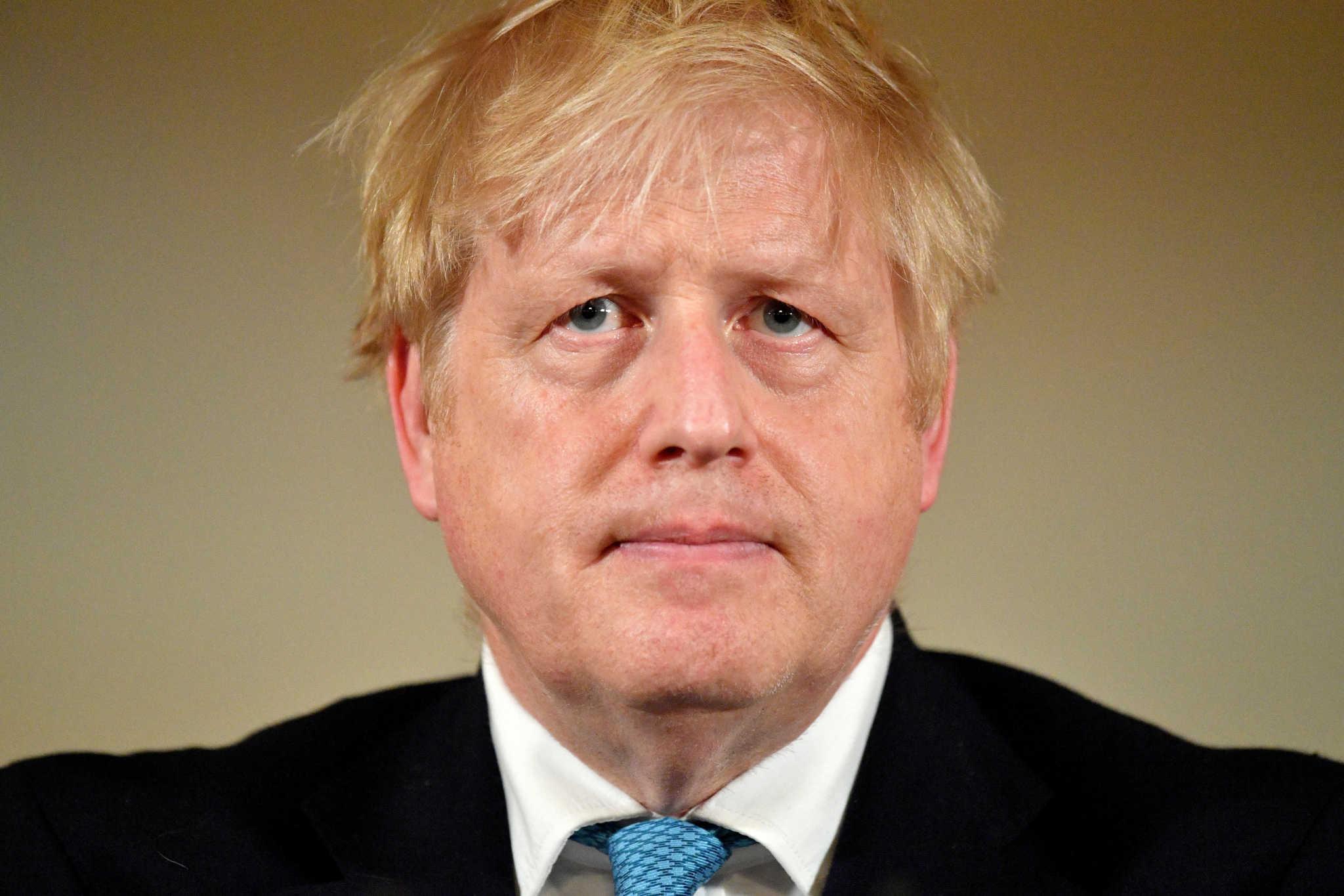 FILE PHOTO: British Prime Minister Boris Johnson looks on during a coronavirus disease (COVID-19) news conference inside 10 Downing Street, London, Britain March 19, 2020.  Leon Neal/Pool via REUTERS/File Photo