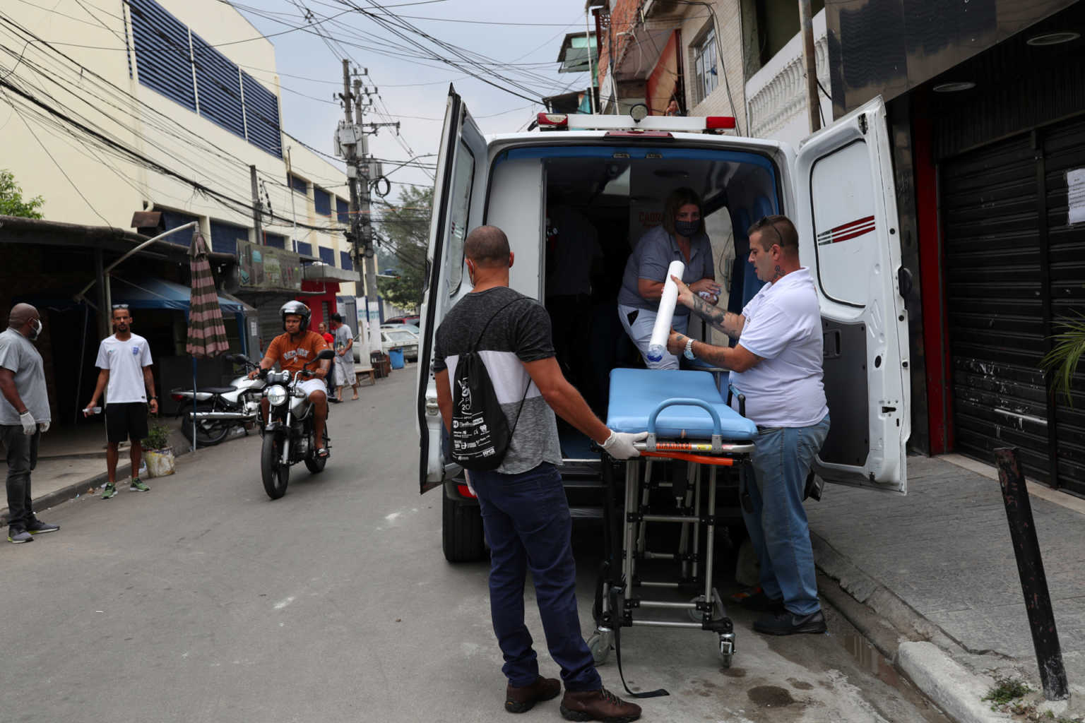Medical personnel prepare an ambulance after residents of the city's biggest slum Paraisopolis have hired a round-the-clock private medical service to fight the coronavirus disease (COVID-19), in Sao Paulo, Brazil March 29, 2020. Picture taken March 29, 2020. REUTERS/Amanda Perobelli