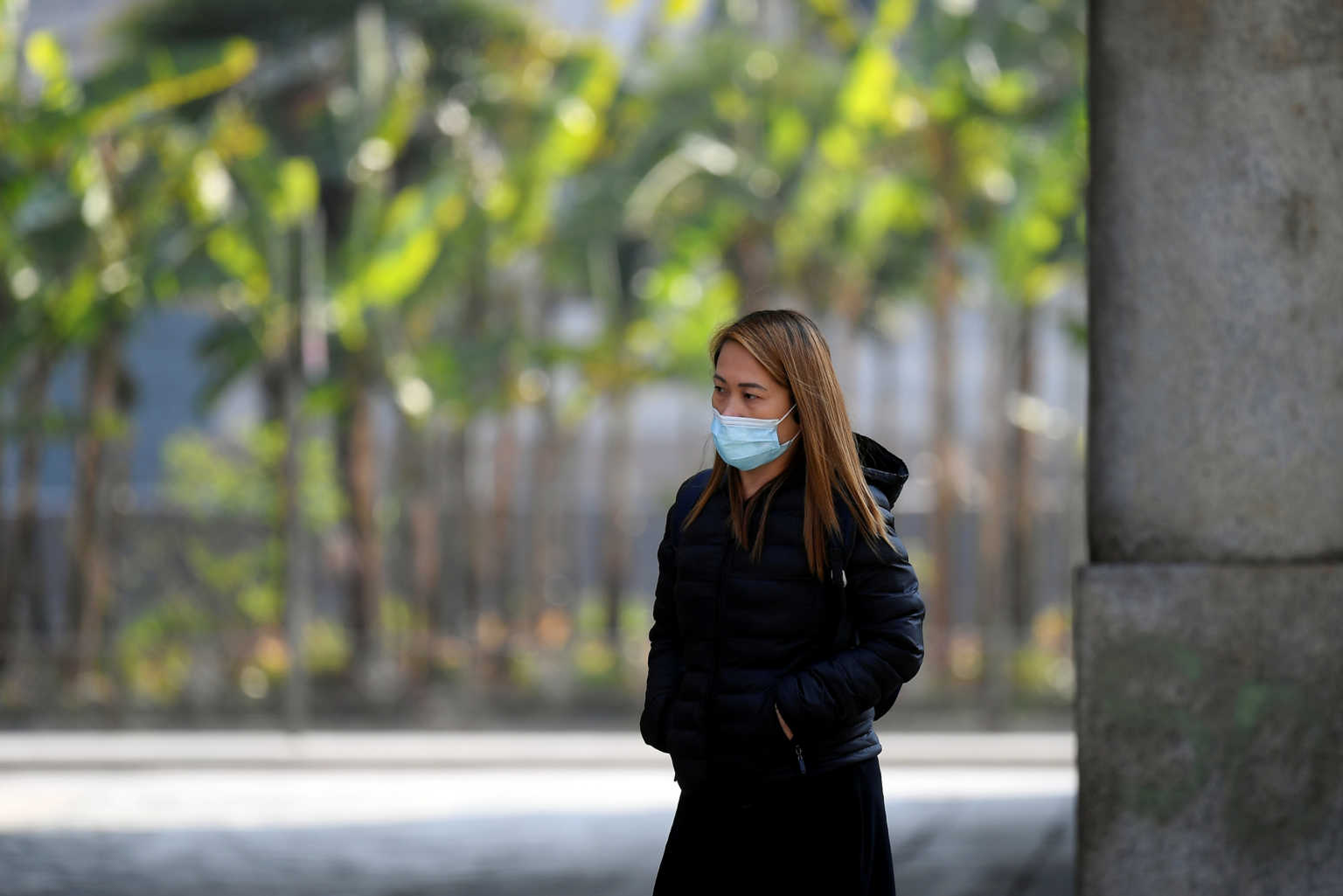 A woman wearing a protective mask walks, as the spread of coronavirus disease (COVID-19) continues, in Milan, Italy April 4, 2020. REUTERS/Daniele Mascolo