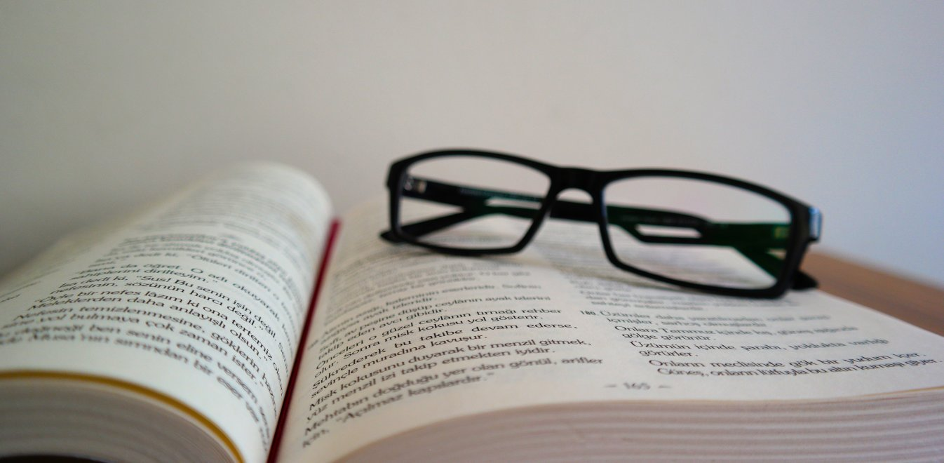 close-up-of-eyeglasses-on-book-336407