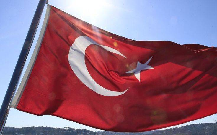 A Turkish flag flies near the Bosporus strait prior to the Bosporus Cross-Continental Swimming Race in Istanbul, Turkey, Sunday, July 24, 2016. More than 2,000 athletes are competing in the 6.5-kilometer challenging race. (AP Photo/Lefteris Pitarakis)