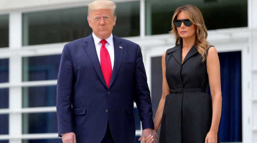 U.S. President Donald Trump and first lady Melania Trump hold hands as they visit the Saint John Paul II National Shrine in Washington, U.S., June 2, 2020. REUTERS/Tom Brenner