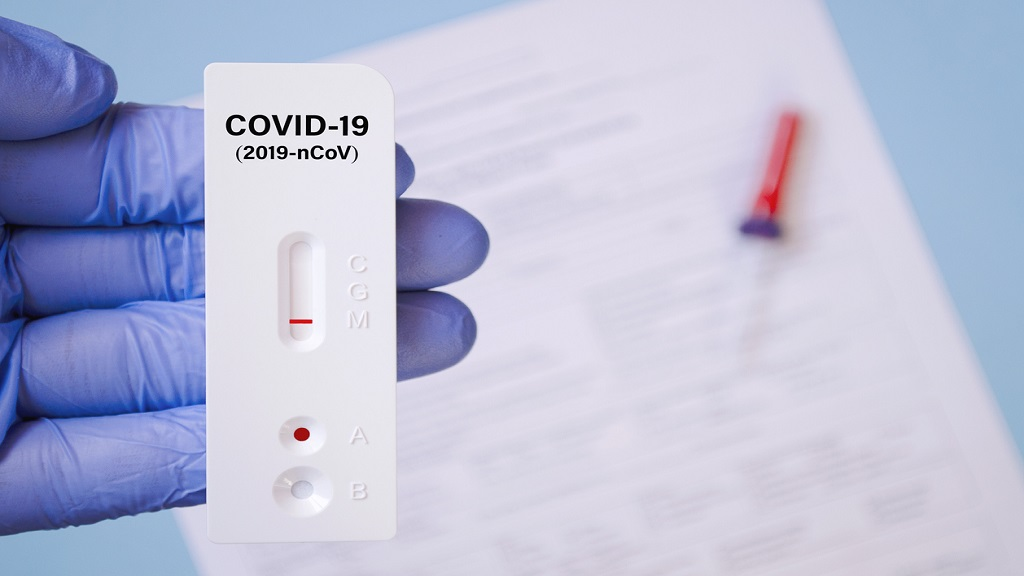 Positive test result by using rapid test for COVID-19, quick fast antibody point of care testing.