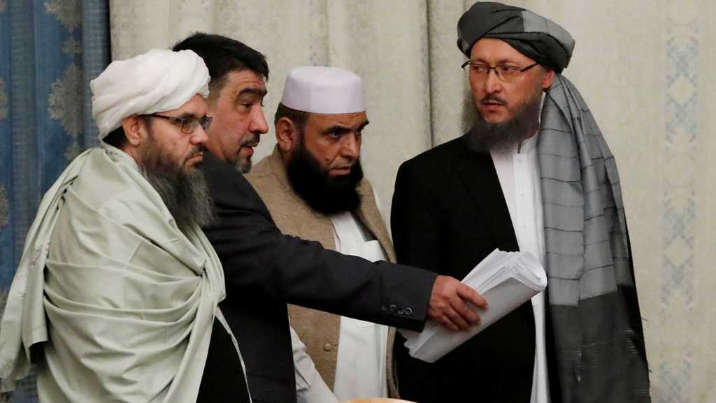 FILE PHOTO: Members of Taliban delegation take their seats during the multilateral peace talks on Afghanistan in Moscow, Russia November 9, 2018. REUTERS/Sergei Karpukhin/File Photo - RC192E7A9DF0
