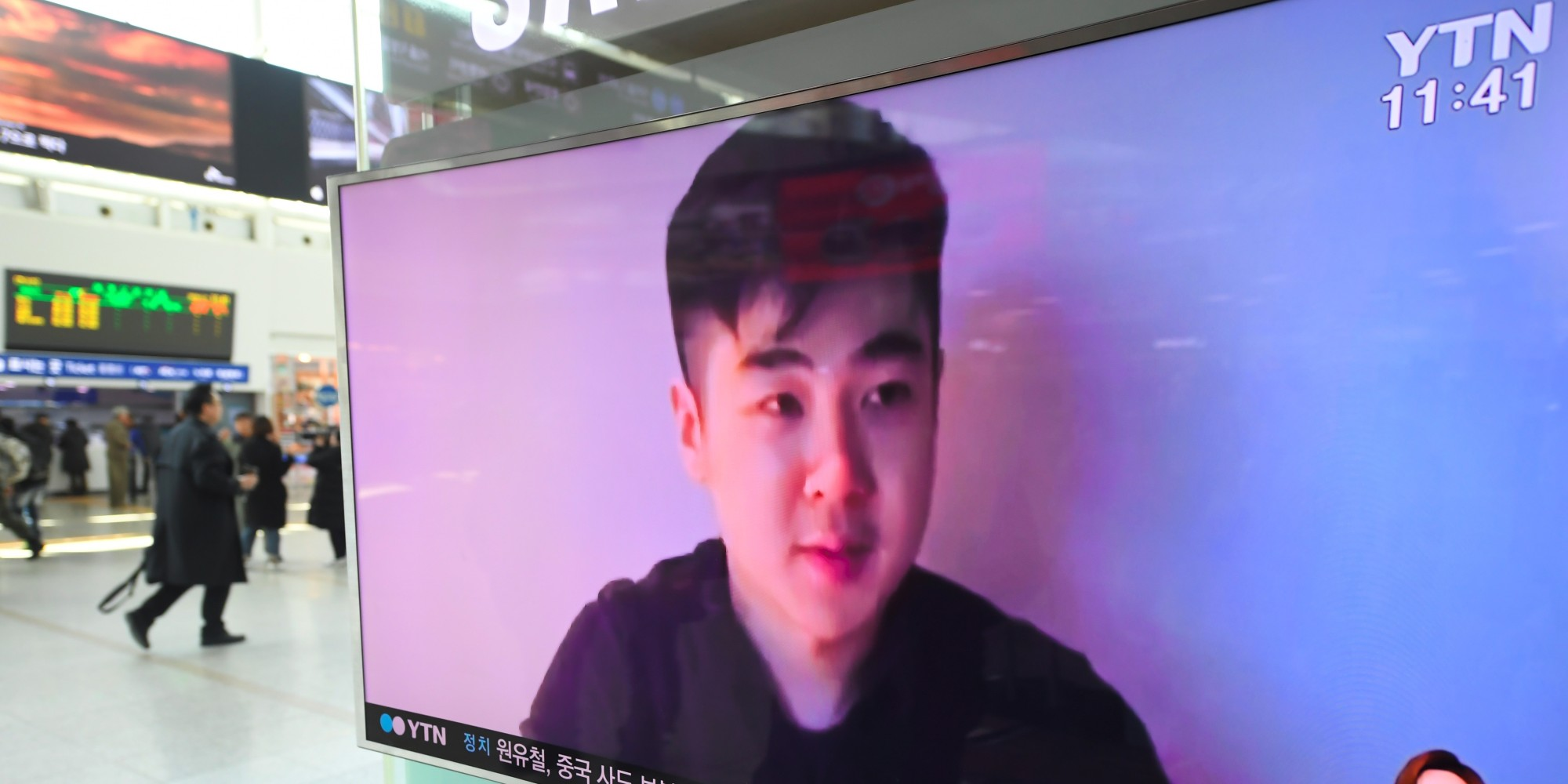South Koreans watch a television news showing a video footage of a man who claims he is Kim Han-Sol, a nephew of North Korea's leader Kim Jong-Un, at a railway station in Seoul on March 8, 2017. The video of a man describing himself as the son of assassinated North Korean exile Kim Jong-Nam emerged on March 8, apparently the first time a family member has spoken about the killing. / AFP PHOTO / JUNG Yeon-Je        (Photo credit should read JUNG YEON-JE/AFP/Getty Images)