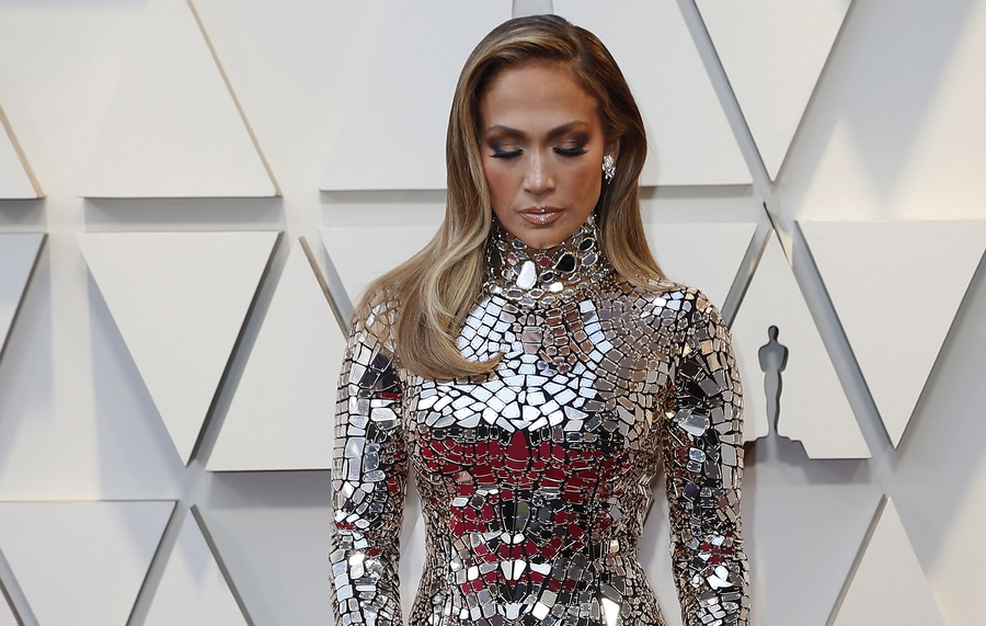 epa08444307 Jennifer Lopez wears a silver plated dress as she arrives for the 91st annual Academy Awards ceremony at the Dolby Theatre in Hollywood, California, USA, 24 February 2019 (reissued 26 May 2020). Silver, also referred to as metallic grey,  became a symbol for prosperity and wealth due to its usage for coins and  jewellery. Not as dominant and showy as glittering gold, silver incorporates the qualities of strength, stability and status, especially in the world of business. In color psychology it is linked with serenity and reflection. Allocated in the middle of black and white, like grey, it is regarded as calm, balancing and stress-reducing.  EPA/ETIENNE LAURENT  ATTENTION: This Image is part of a PHOTO SET *** Local Caption *** 55010529