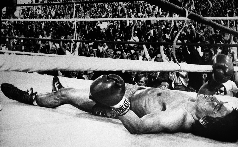"Korean lightweight Duk Koo Kim lies unconscious on the canvas, Nov. 13, 1982 in Las Vegas, seconds after Ray ""Boom Boom"" Mancini unleashed a vicious left-right combination to Kim's head to begin the 14th round of their World Boxing Association lightweight title bout. Kim was listed in critical condition at Desert Springs Hospital where he underwent surgery for bleeding in the brain. (AP PhotoScott /Henry)"